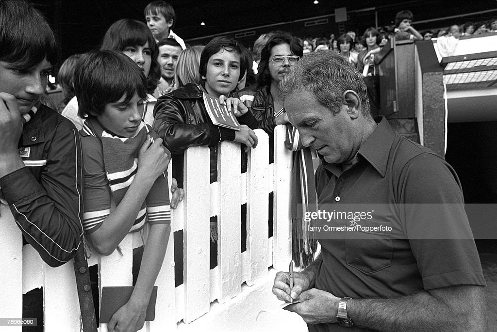 12th August 1978, Old Trafford, Manchester, Manchester United Manager Dave Sexton signs autograph for supporters during an Open day