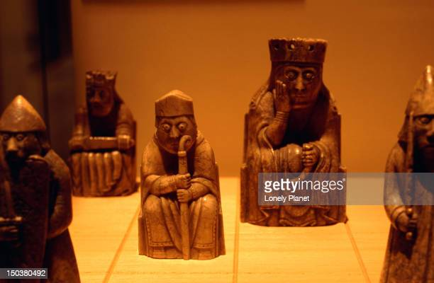 12th century chess pieces (the lewis chess men) in the museum of scotland. - only men stockfoto's en -beelden