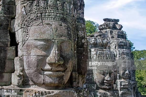 12th century stone faces at Angkor Thom / Nokor Thom, capital city of the Khmer Empire, Siem Reap, Cambodia.