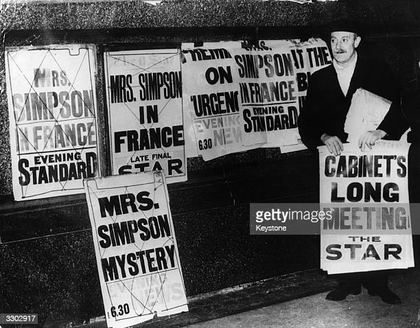 Newspaper placards declaring 'Mrs Simpson Mystery' and 'Mrs Simpson in France' at the time of the abdication of King Edward VIII