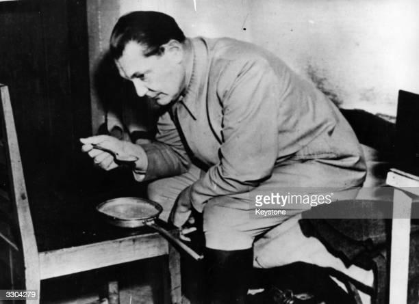 Hermann Goering eating whilst awaiting sentencing at Nuremberg War Crime Trials