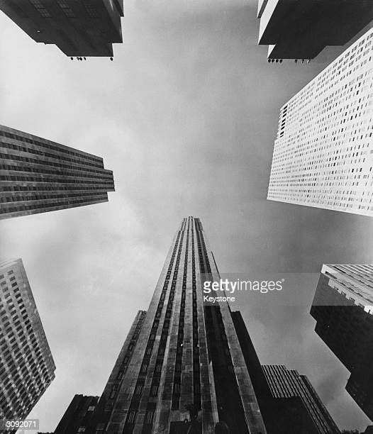 Just above the statue of Prometheus in the Rockefeller Centre, New York, is the RCA building and in clockwise order is from the left is the Time and...
