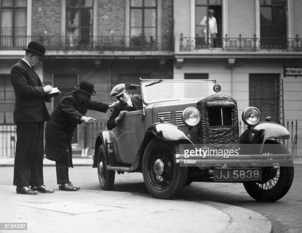 An Alfa Romeo being driven by a novice driver Watching him is an RAC examiner on the left and centre a prospective driving instructor The RAC have...