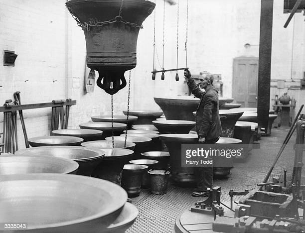 A bell is lifted in the tuning room at John Taylor's bell foundry Loughborough These bells are for Manchester Town Hall and for the Cathedral Church...