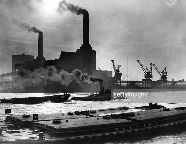 Smoke belches from the famous chimneys of London's Battersea Power Station