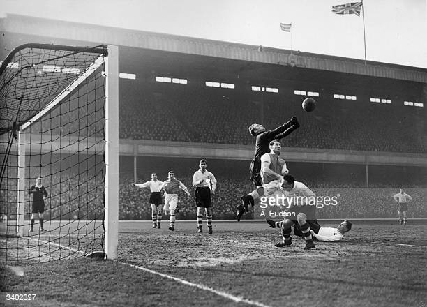 Preston North End goalkeeper Holdcroft clears from Arsenal's Crayston