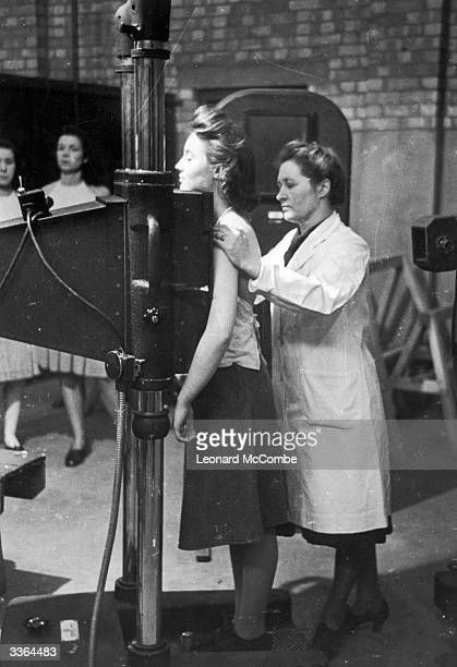 London factory workers being Xrayed using a mobile radiography unit travelling from borough to borough during a mass radiography programme set up to...