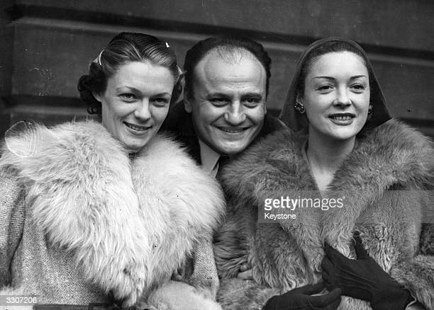 Fashion models Suzette and Praline with designer Pierre Balmain arrive at Victoria to display Balmain's fur designs in London