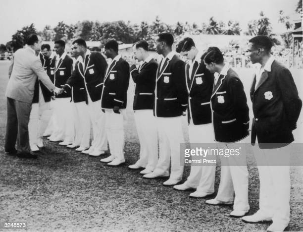 Governor Sir Robert Arundell shakes hands with members of the West Indian cricket team before the start of the second Test Match at Bridgetown,...