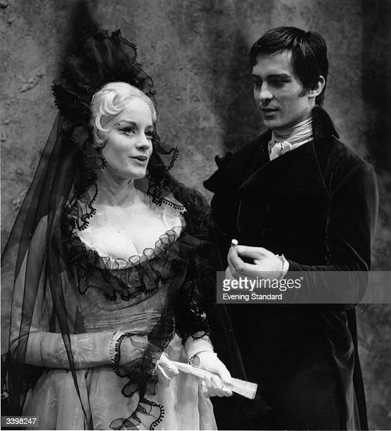 Actors Jeremy Brett and Mary Ure co-starring in a theatrical costume drama.