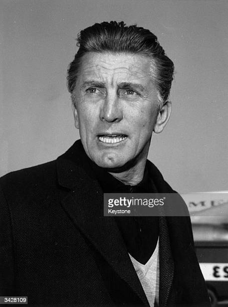 Film Star Kirk Douglas in Rome airport on his way to a safari in Kenya.