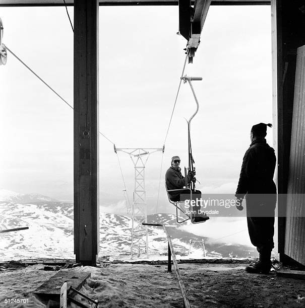 12th February 1962 Tourists using the ski lift at a resort in Aviemore in the Cairngorm Mountains which is capable of taking over 5000 skiers up to...