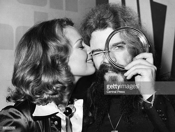 Pop singer and songwriter Roy Wood of the group Wizzard peers at the award he has just received for being the Top Musician in the Disc Music Poll...