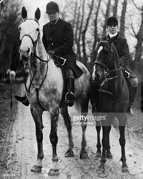 British chancellor of the exchequer Winston Churchill with his son Randolph on their arrival at Dampierre near Dieppe France where they will take...