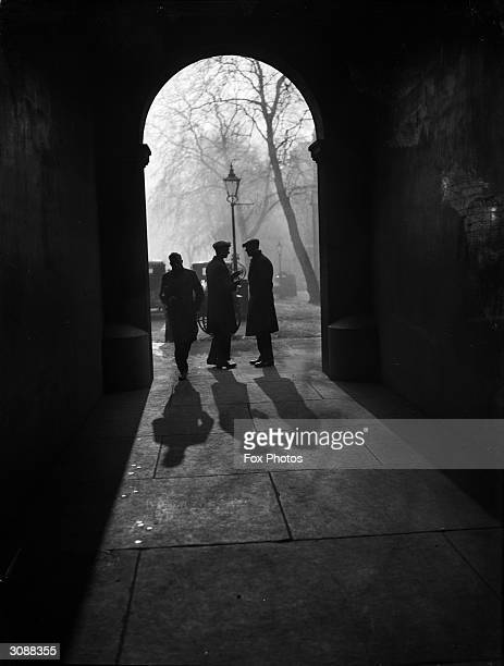 Elongated shadows falling in an archway of Temple one of the Inns of Court in London