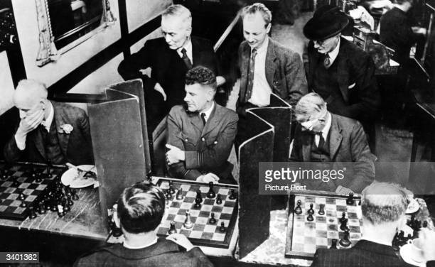 Group of chess players at the Gambit restaurant in London, where customers play chess over lunch. The players are playing a special version of chess...