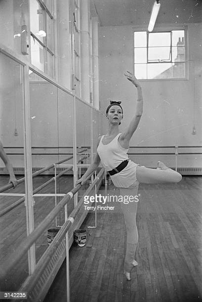 English ballet dancer Antoinette Sibley rehearsing at the barre
