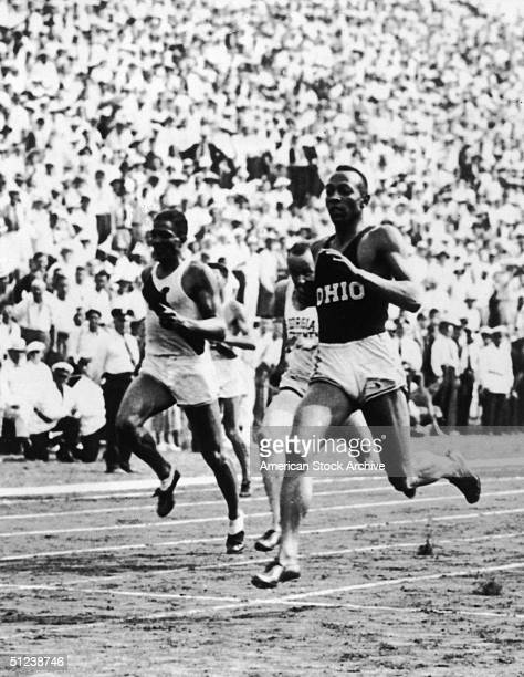 12th July 1936, American athlete Jesse Owens wins the men's 200m event during a track meet, New York City.