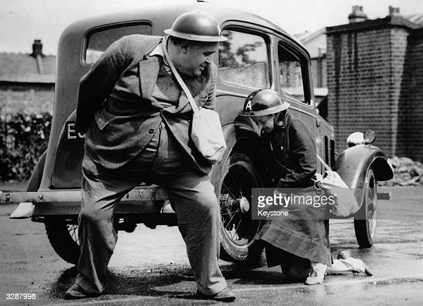 20stone ARP warden John Turner lifts up a car to help a colleague change the tyre on her car