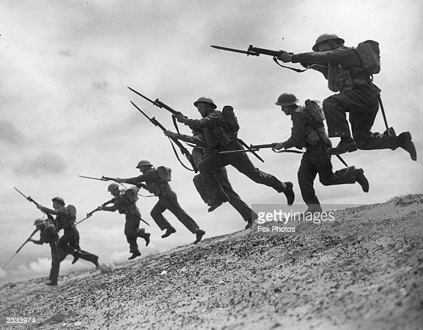 An impressive bayonet charge during a training session at military camp in a North West coastal town where the beach makes an ideal training ground...