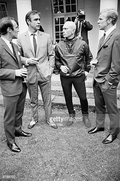 From left to right Jimmy Greaves Sean Connery Yul Brynner and Bobby Moore during a visit by the England football team to Pinewood Studios