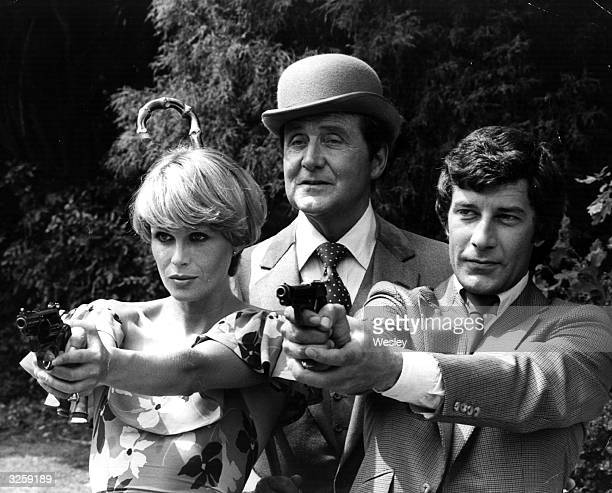 The three main characters in the television series 'The New Avengers' together at Pinewood Studios From left Joanna Lumley as Purdey Patrick MacNee...