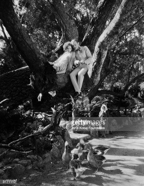 SwedishAmerican actress Greta Garbo as the glamorous Russian spy Tania in the romantic drama 'The Mysterious Lady' directed by Fred Niblo She sits...
