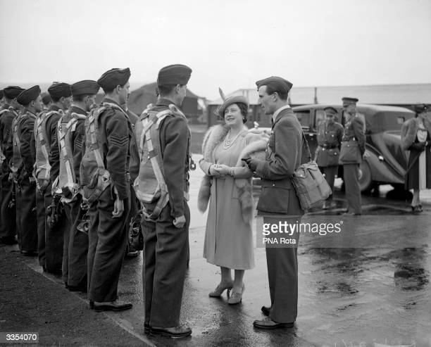 Queen Elizabeth Queen Consort to King George VI talking to airmen during a visit to a Royal Air Force barracks