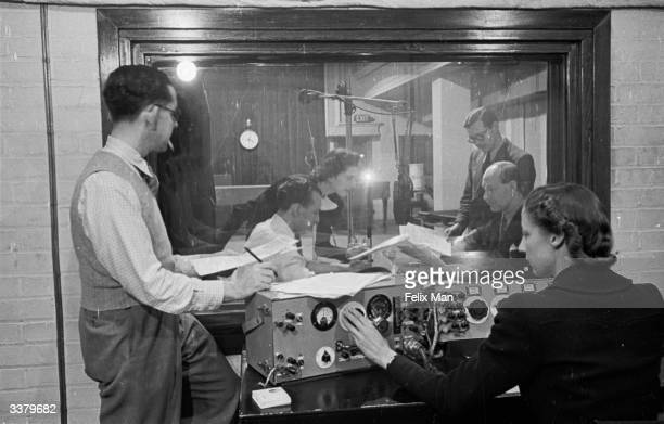 Journalists broadcasting the programme 'This Is London Calling Europe' from the BBC European Service control room, London. The BBC's overseas...