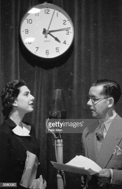 Producer Lionel Gamlin and Elizabeth Cowell assistant broadcast to the women of Europe from the BBC European Service control room London The BBC's...