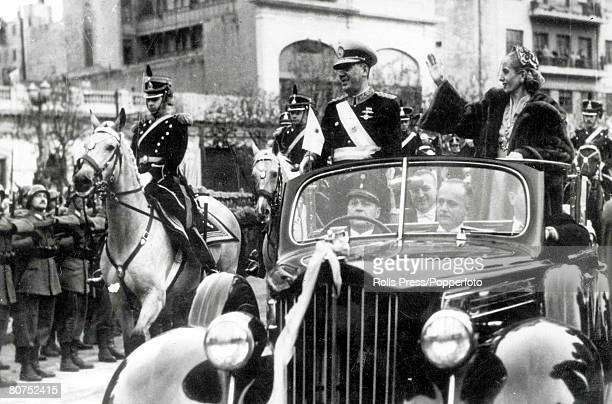 12th June 1952 Argentina President Juan Peron and his wife Eva Peron wave as they ride down the Avenida de Mayo in Buenos Aires after the...