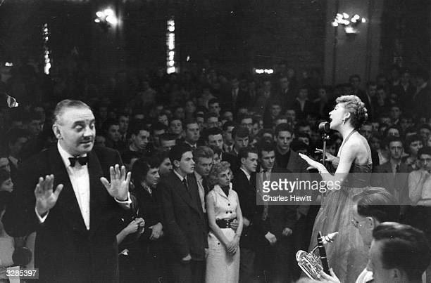 Ted Heath conducting his band whilst Kathy Lloyd sings at the Wolverhampton Palais de Danse Original Publication Picture Post 7178 Ted Heath...