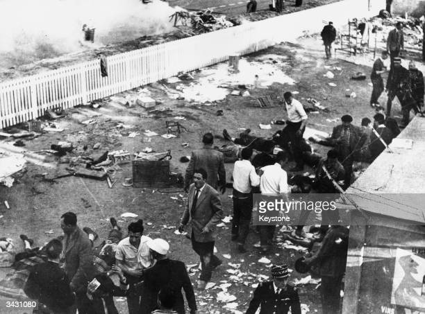 The wreckage at the Le Mans racecourse the day after Pierre Levegh's Mercedes crashed through the barrier into the crowds killing 80 people and...