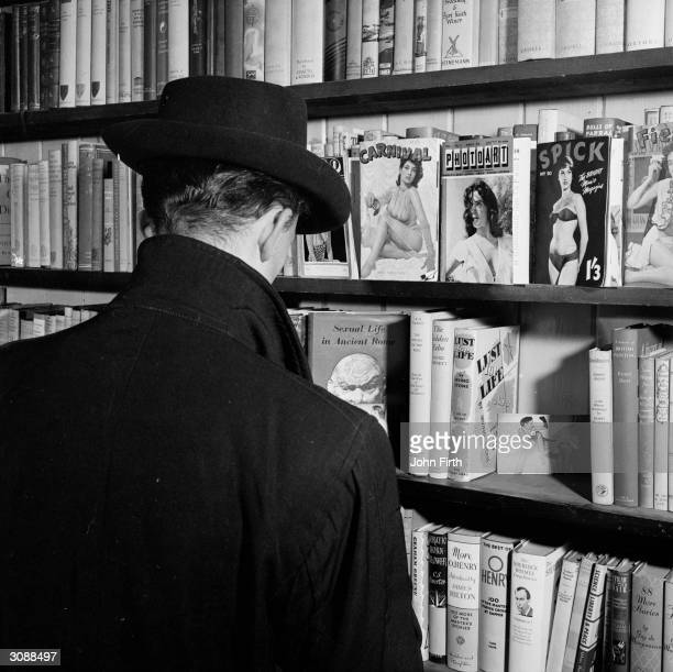 A peruser contemplates the pornography section at a Soho sex shop in London