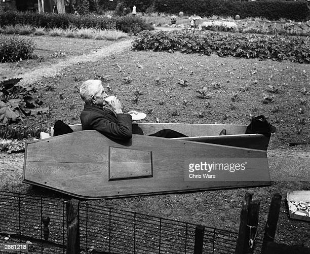 Archie Miller drinking a cup of tea in the solid oak coffin he bought to ensure he would leave this world in real style