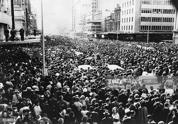 A vast crowd gathers outside the Town Hall in King William Street to welcome the Beatles to Adelaide