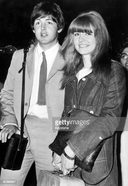 Beatles singer songwriter and bass player Paul McCartney arrives back in London with girlfriend actress Jane Asher after spending a holiday at the...