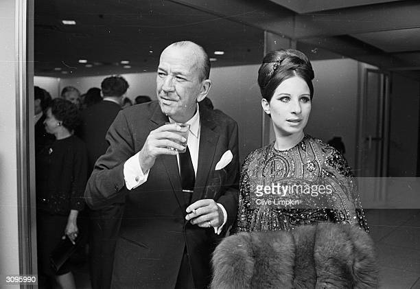 Pop singer and actress Barbra Streisand with British playwright and actor Noel Coward .