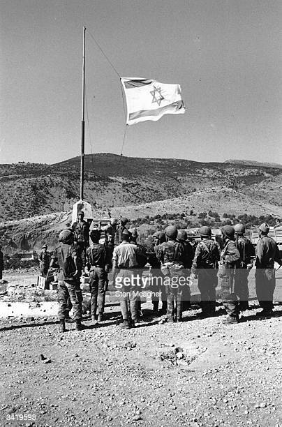 Israeli troops salute their flag as they occupy Syrian territory during the Six Day War