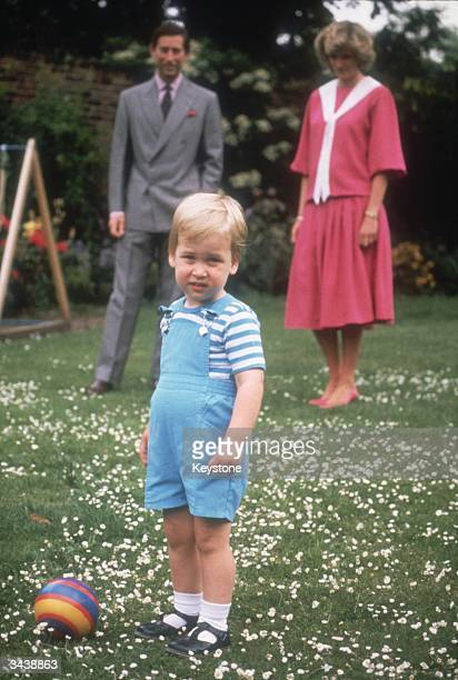 Diana Princess of Wales and Charles Prince of Wales in the gardens of Kensington Palace with their son Prince William on his second birthday