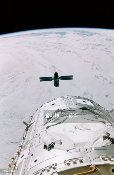 Zarya, the first component for the International Space Station, approaching Unity, the second stage of the project, which is attached to the NASA...