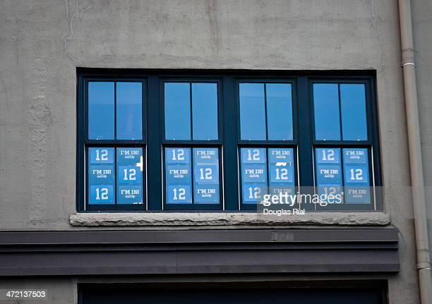 12th Man Signs In Building Window