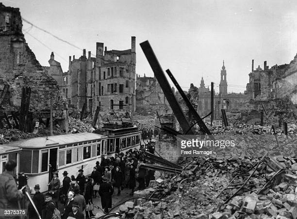 Bomb damaged Dresden commuters boarding a tram