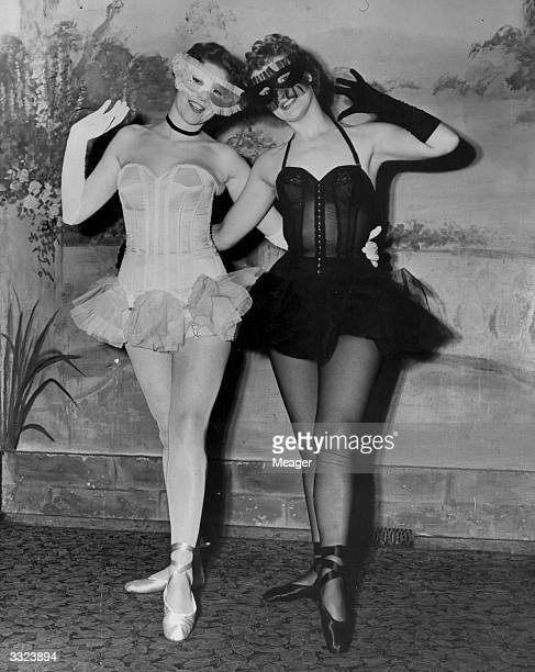 Two masked ladies modelling corsets from the British Corset House at the Mayfair Hotel London for the preview of National Corset Week