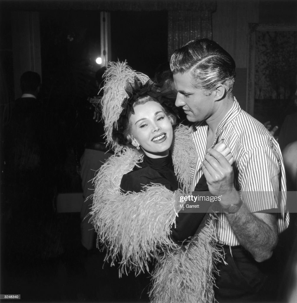 Zsa Zsa Gabor and Richard Webb (1915 - 1993) dancing at a nightclub in Hollywood.