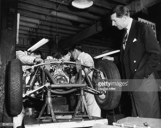 Formula One team owner Rob Walker oversees the assembly of a new British Grand Prix racing car at his garage in Dorking The car a collaboration...