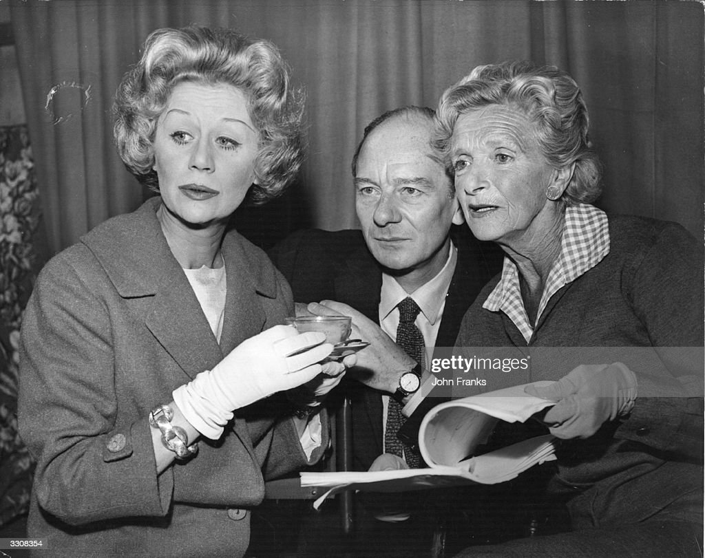 Margaret Leighton (1922 - 1976), Sir John Gielgud (1904 - 2000) and Gladys Cooper (1888 - 1971) go over their latest script at rehearsals. The play 'A Day by the Sea', was produced by Associated Television.