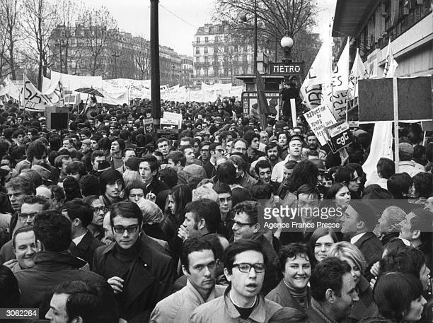 Some of the hundred thousand people who gathered in Bastille Square Paris for National Strike day Trade Union members both blue and white collar and...