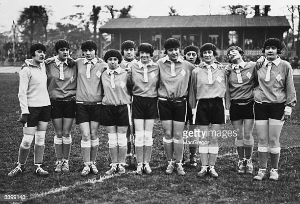 The French women's football team complete with berets line up before the England vs France Women's International Football match in aid of shipwrecked...