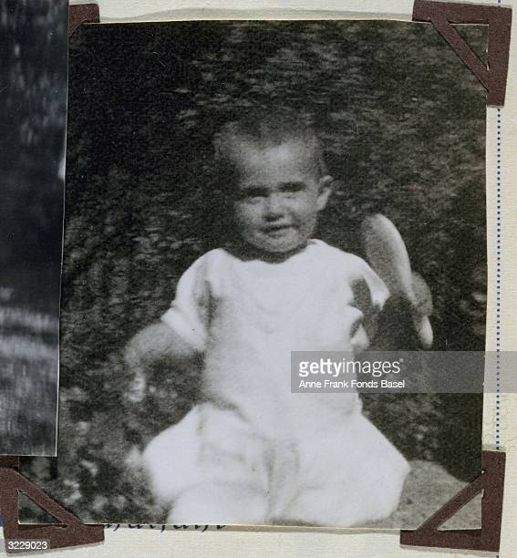 EXCLUSIVE Portrait of Margot Frank older sister of Anne Frank holding a hairbrush in a garden taken from her photo album Aachen Germany